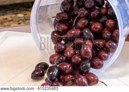Black Olives In Pot Over The Sink For Recipe Preparation