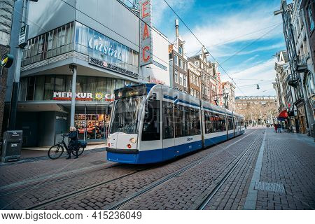 Amsterdam, Netherlands - March 2020: Tram In Downtown Of Amsterdam, Street Scene From Historical Cen