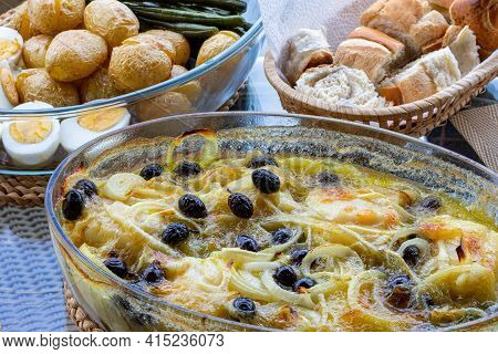 Cod Loin Baked In Olive Oil, With Potatoes, Broccoli, Boiled Egg And Black Olives. Typical Dish Of P