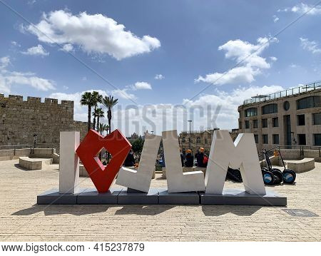 Jerusalem, Israel - March 08, 2021: I Love Jerusalem - A Modern Tourist Attraction On The Background