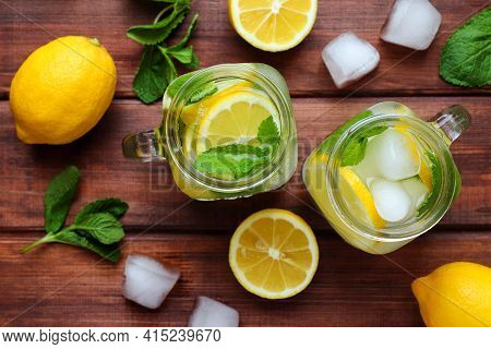 Fresh Citrus Lemonade With Lemons, Mint And Ice On A Wooden Table. Summer Refreshing Drinks. Close-u