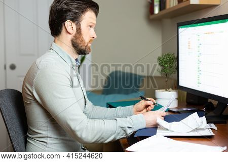Man Working From Home On Desktop Computer With Paperwork. Hd 24fps.