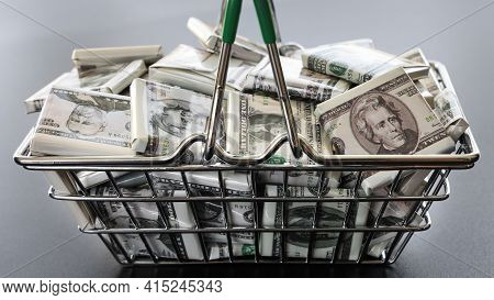 Basket Is Filled With Dollars In Form Of Wrapper Candies, Close-up. Concept Of Success And Rich, Dep
