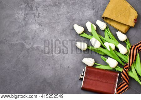 May 9. St. George Ribbon, Flask, Military Cap With White Tulips On A Gray Background. The Traditiona