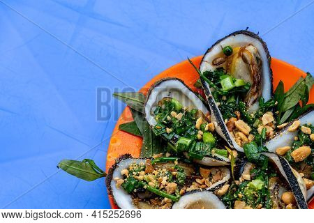 Tasty Vietnamese Styled Grilled Mussels Served With Scallion And Peanuts
