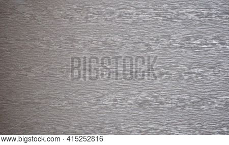 Rough-finished Surface Of Dark Gray Metal With Characteristic Sanding Marks.