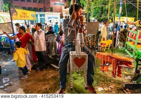 Howrah, West Bengal, India -14th April 2019 : Boy Child Riding On Nagordola- A Traditional Amusement