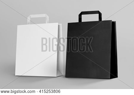 White and black paper shopping bag with design space