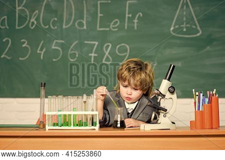 Technology And Science Concept. Kid Study Biology And Chemistry In School. School Education. Explore