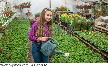 Summer Farm. Horticulture. Gardening Activity For Kid. Happy Teen Girl Florist In Greenhouse.