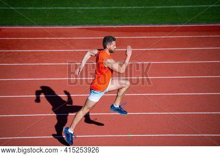 Athletic Guy Run. Challenge And Competition. Marathon Speed. Sprinter. Man On Running Track.