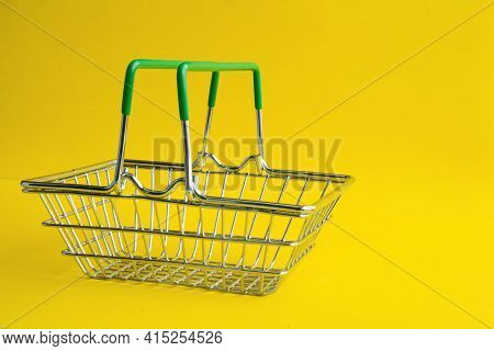 The Grocery Basket Is Empty. Metal Basket For Purchases In The Store. Stacking Products.
