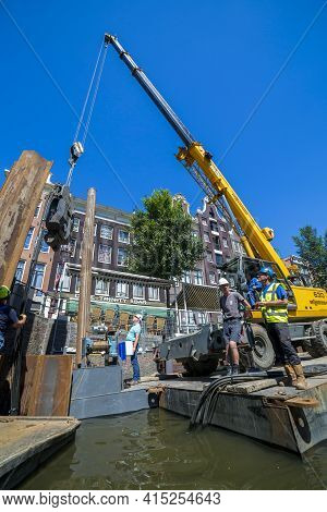 Amsterdam, Netherlands - July 02, 2018: Construction And Installation Works On The Embankment Of Ams