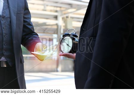 Two Business Men With Money And Time . Business Man Using Money Buying Time That He Can Manage Time