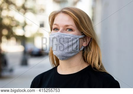 Blonde woman wearing mask in the city outdoor photoshoot