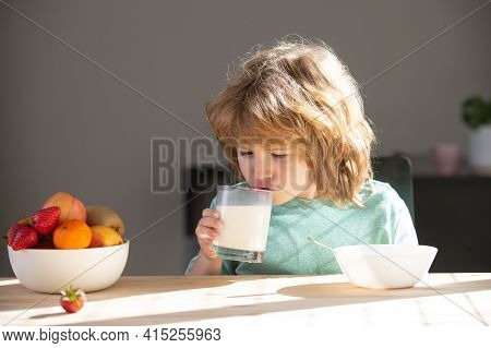 Child Drinking Milk Glass. Close Up Of Cute Little Boy Kid Drink Tasty Organic Milk With Vitamins Ca