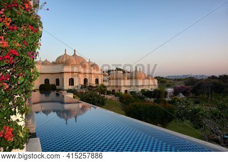 UDAIPUR, INDIA - JANUARY 21, 2017: Pool at the Oberoi Udaivilas Hotel. Located on the bank of Lake Pichola the hotel has over fifty acres, which includes a twenty-acre wildlife sanctuary.