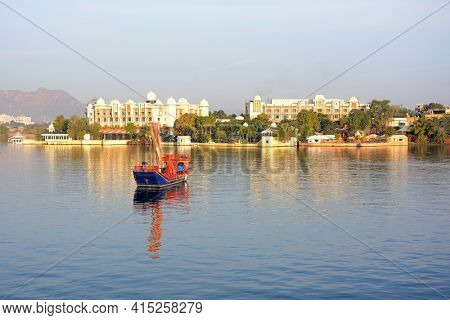 UDAIPUR, INDIA - JANUARY 13, 2017: Ganguar Ceremonial Barge at theTaj Lake Palace Hotel. The 150-year old boat is used for floating processions, celebrating festivals and royal ceremonies.