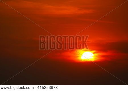 Beautiful Sunset Orange Yellow Red Silhouette Dark Sky In Back On Cloud