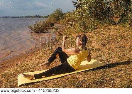 Senior Woman Making Yoga Near River, Summer.