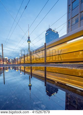 Berlin, Germany - March 21, 2021 - View Of The Famous Alexanderplatz With A Moving Tram At Dusk - Al