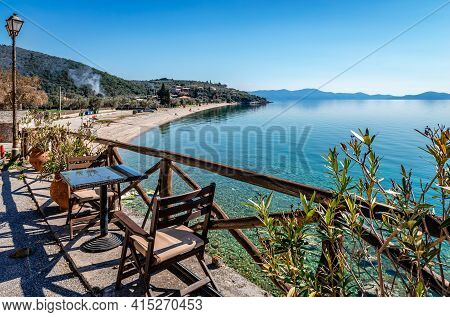 High angle view of Abovos beach in Afissos, a traditional village built amphitheatrically on the slopes of Mount Pelion, with view to the Pagasetic Gulf. In Thessaly, Greece.