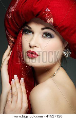 beautiful girl in the red fabric
