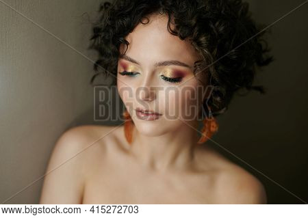 Elegant Young Woman With Closed Eyes On Beige Color Background