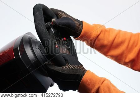 Holding Sport Wheel In Gloves And Driving Side View Isolated
