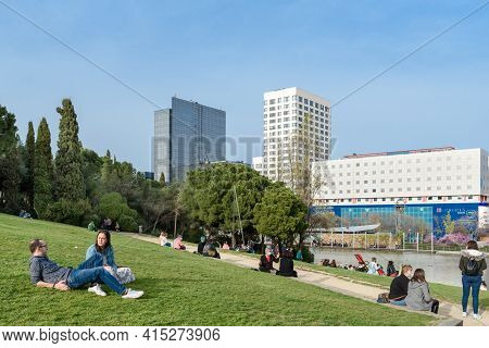 Sabadell - Catalonia, Spain - April 1st Of 2021: View Of The Parc Catalonia With People Laying On Th