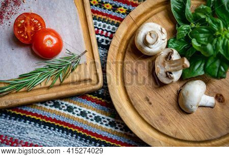 Food Ingredients For Pizza Or Pasta Dishes. Fresh Cherry Tomatoes, Mushrooms, Basil Leaves, Olive Oi