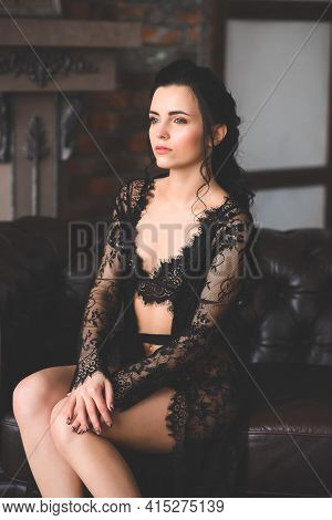 Woman Posing In Black Lace Lingerie. Sensual Beautiful Lady Has Returned To Erotic Underwear.