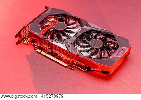 Graphic Video Card  With Red Backlight. Gpu Card. Mining Cryptocurrency Concept