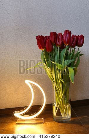 Neon Moon Sign With Beautiful Red Tulips. Trendy Style. Floral Background. Neon Sign. Custom Neon. H