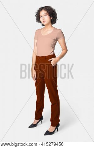 Woman in red slack pants and pink tee full body