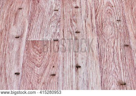 Linoleum Flooring With Nice Embossed Wood Texture. Imitation Wooden Floor In Pink Color