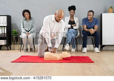 Cpr First Aid Lifeguard Or Paramedic Class With African Students