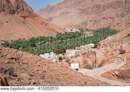 Arabian Mountain Village Of Harat Bidih In The Gorge Of Wadi Tiwi, Oman. Oasis In A Dry, Deep Desert