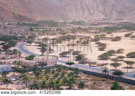 Small Mosque In The Rural Area Of Musandam Province Suburbs Of Bukha Village, Oman. Palm Trees In Th
