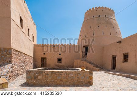 Courtyard Of A Small Medieval Arabian Fort In Bukha, Oman. Stairs And Square Tower. Hazy Day In Arab