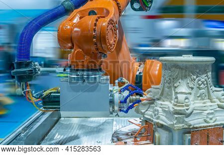 Milling machine cutting marble workpiece at futuristic technology exhibition.  CNC engraving, carving, industrial and manufacturing concept