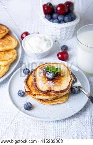 Cottage Cheese Pancakes (syrniki). Homemade Cheesecakes From Cottage Cheese With Sour Cream, Berries