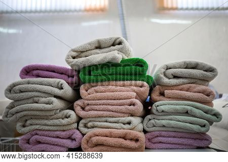 Stacks Of Multicolored Terry Towels On The Table