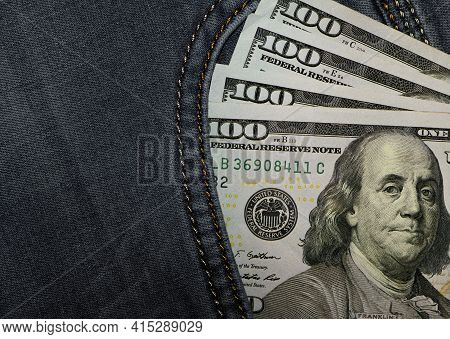 Money, Dollar Bills In Jeans Pocket. Us Dollars Are Visible In Your Pocket. 100 Dollar Bills Stickin