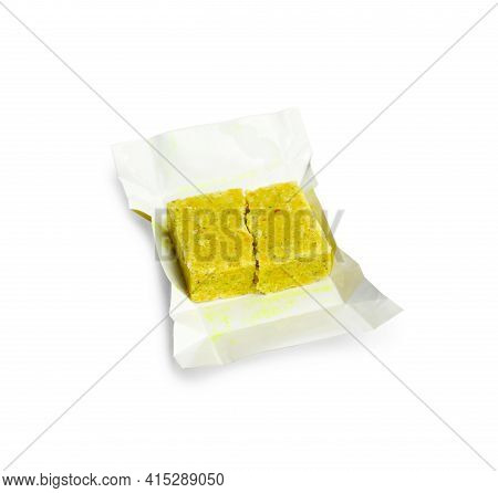 Unwrapped Bouillon Cube On White Background. Broth Concentrate