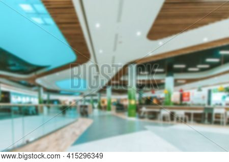 Escalator People Blurred Background. Interior Of Retail Centre Store In Soft Focus. People Shopping