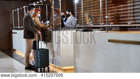 New Guests Arriving In The Hotel With Their Luggage