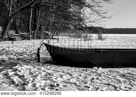 Rowing Boat In The Snow On A Frozen Lake In Poland, Monochrome