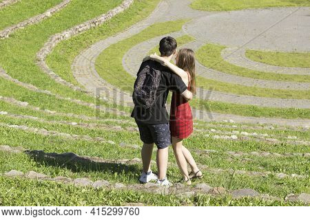 A Young Couple In Love, A Guy And A Girl Rejoice, Hug, Indulge And Play In The Summer Park In Nature