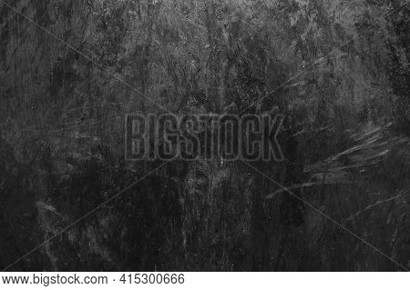 Black And White Old Dirty Grunge Surface Scratched Dark Metal Texture Background.